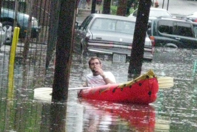 This pic is from a number of years ago when it flooded in my neighborhood.  That man is boating in the middle of the street.  Seemed appropriate.